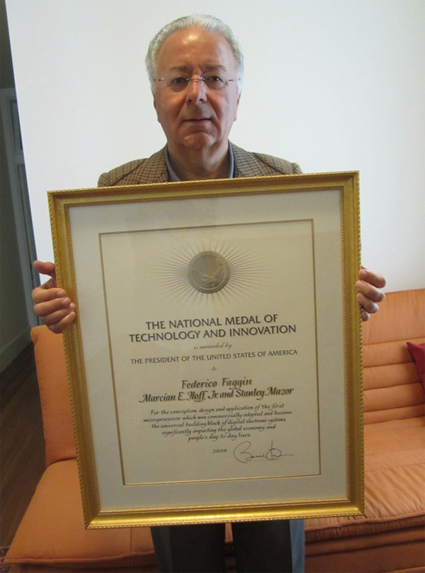 Federico holding the  National Medal of Technology and Innovation diploma
